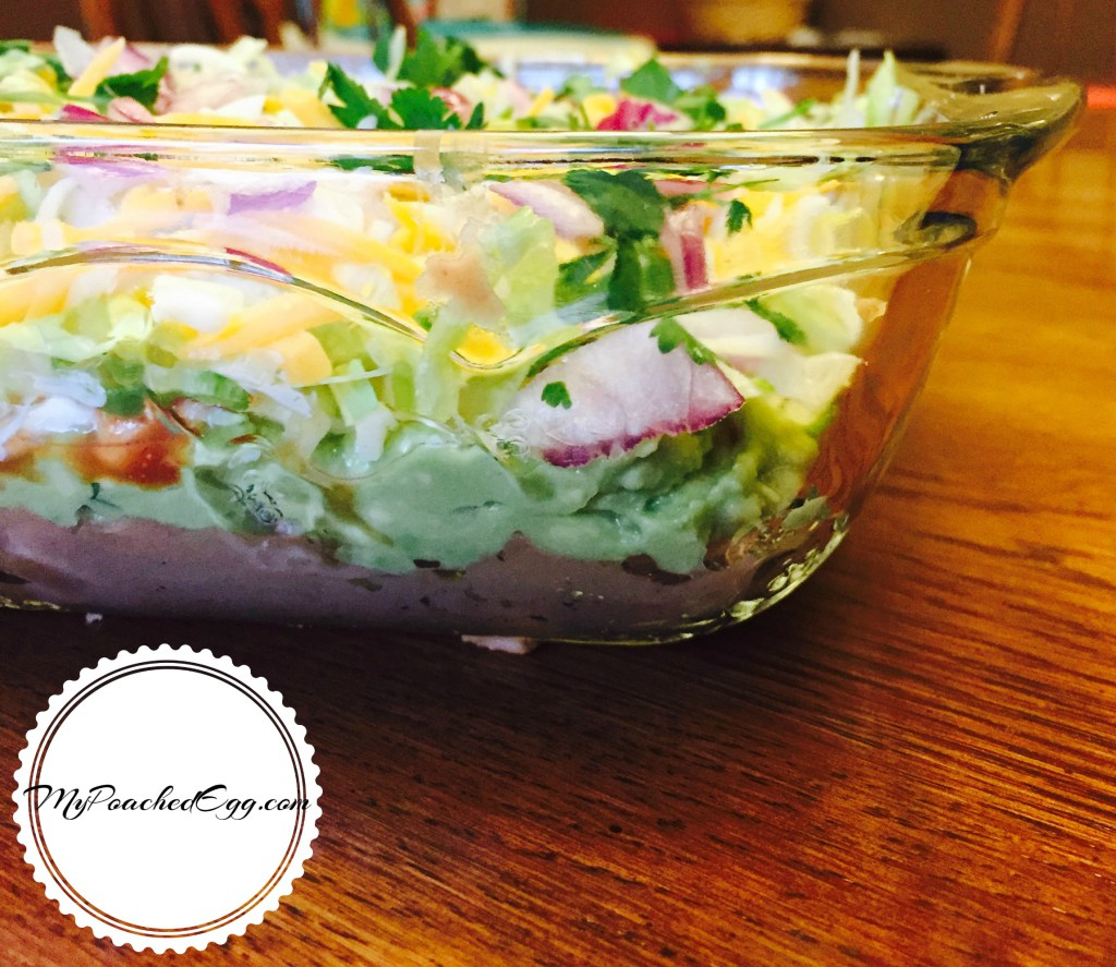 7 Layer Taco Dip. Find this and more great recipes for your summer potluck here.