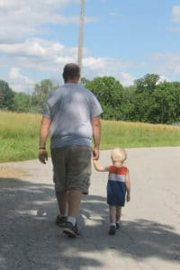 Daddy and boy walking