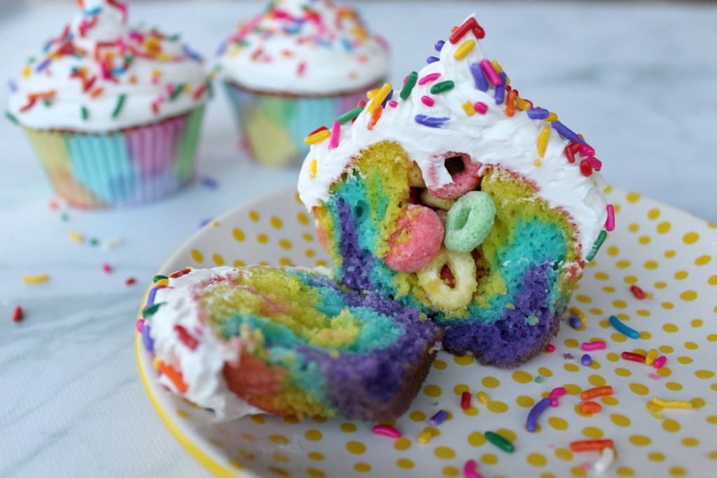 Rainbow surprise cupcakes. Find this and more great ideas for your summer potluck here.