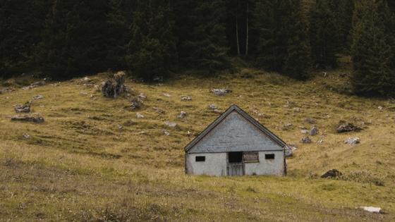 small house in a field